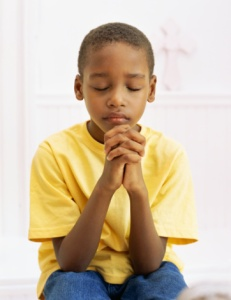 close-up of a boy praying