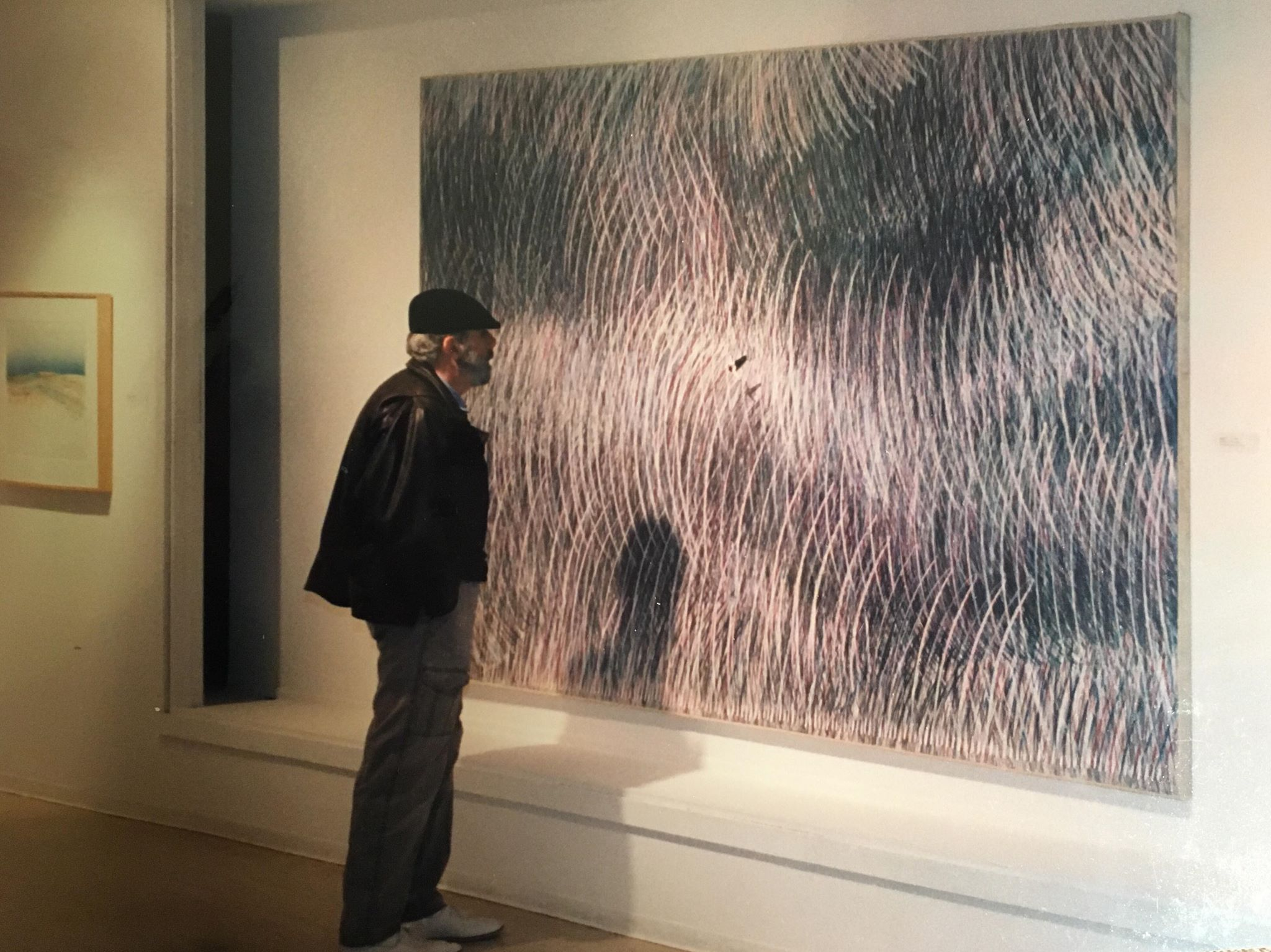 dad in front of his art